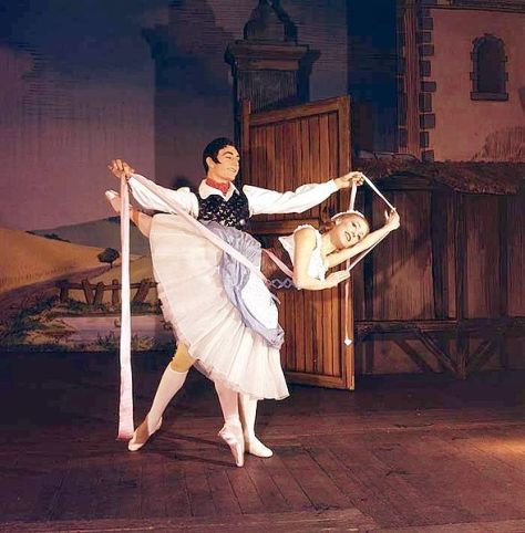 Nadia Nerina as Lise and David Blair as Colas in the Pas de ruban from the premiere of Frederick Ashton's version of La Fille mal gardée. London, 1960.