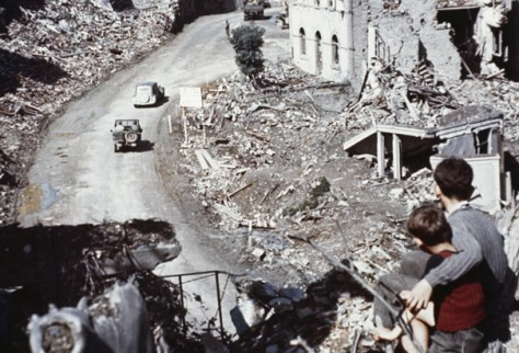 st-lo-in-ruinsSt Lo France in Ruins After Normandy Invasion June 1944 two boys overlooking the ruined remains of the village of St Lo France after the DDay invasion of Normandy.