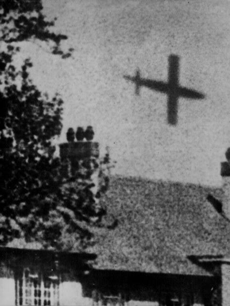ww2A V-1 rocket in flight over London, ca. 1944.