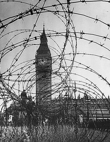 WWII, Europe, London, England, Big Ben with barbed wire entanglement.