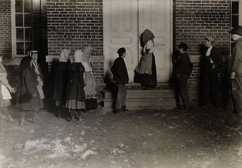 Child workers on their way to a twelve-hour night shift at Whitnel Cottton Mills. North Carolina, USA. December, 1908.