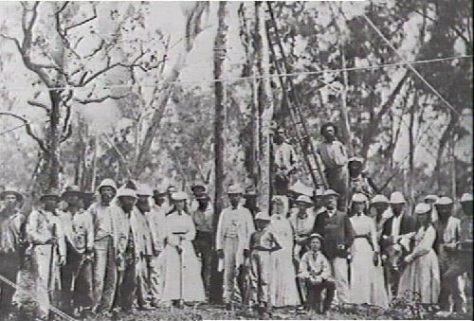 On the fifteenth of September, 1870, people lined up to be photographed at the planting of the first telegraph pole near Palmerston in Australia.