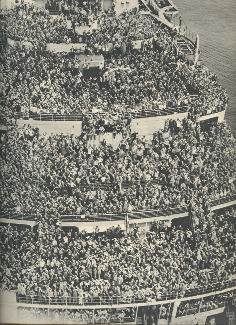 Passengers on board the Queen Elizabeth—a contingent of 14,000 American soldiers beginning their journey home following the defeat of Hitler.