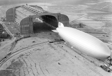 The German-built zeppelin Hindenburg trundles into the U.S. Navy hangar, its nose hooked to the mobile mooring tower, at Lakehurst, New Jersey, on May 9, 1936.