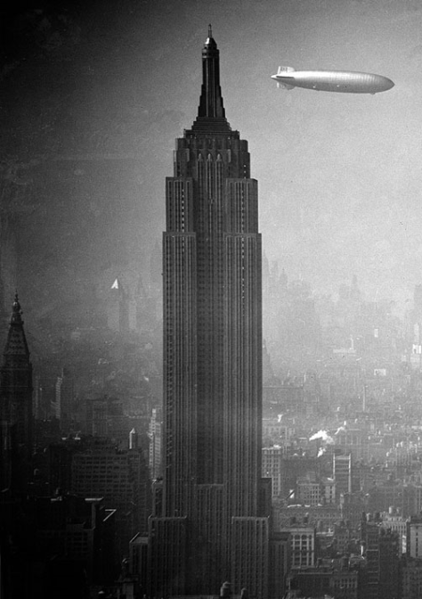 The German zeppelin Hindenburg floats past the Empire State Building over Manhattan, on August 8, 1936, en route to Lakehurst, New Jersey, from Germany.