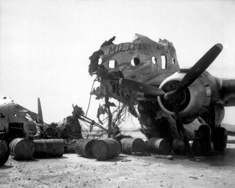 Wreckage of a C-54 destroyed on the ground at Kimpo Airfield by North Koreans on 25 June 1950. Photographed on September 18 1950.