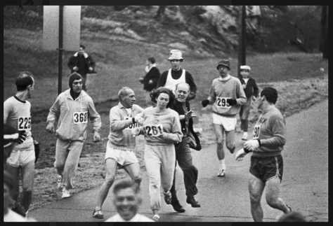 1967 A race official tries to physically remove Kathrine Switzer - the Boston Marathon's first registered female runner - from the race, while other runners try to protect her. It would be another five years before women were allo