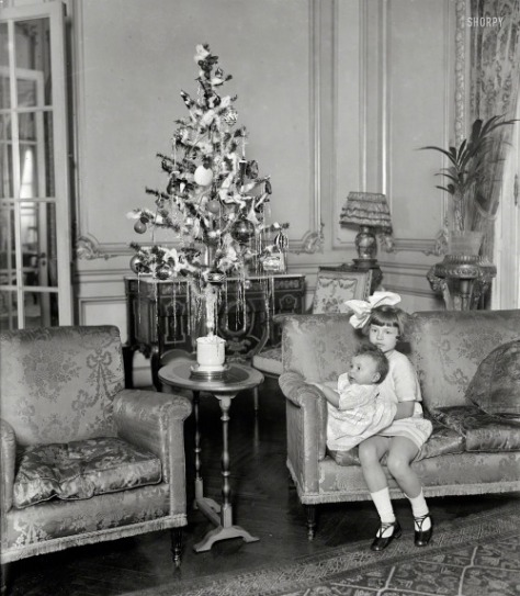 26th December, 1924. Washington D.C. Nevine and Nemai Yousry. Children of the Egyptian ambassador, with their Christmas tree.