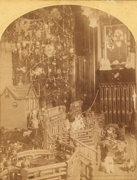 Christmas in America. 19th Century.Christmas tree with toys around, including doll houses, by Roberts & Fellows 2.