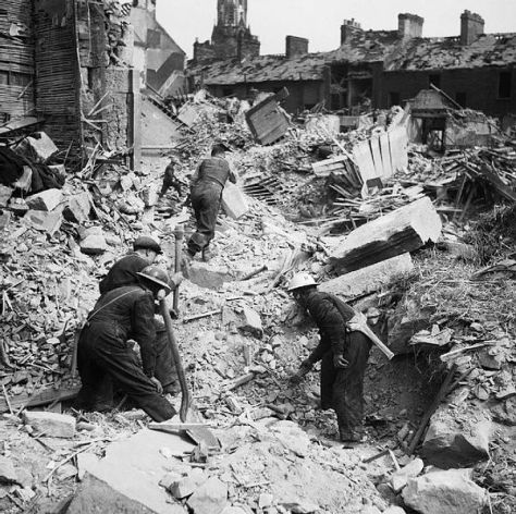 Rescue workers search through the rubble of Eglington Street in Belfast, Northern Ireland after a German Luftwaffe air raid, 7 May 1941.