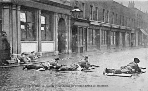 Soldiers from the Scots Guards open fire at the terraced house on Sidney Street London 3rd January 1911