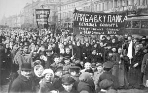 A demonstration of workers from the Putilov plant in Petrograd (modern day St. Peterburg), Russia, during the February Revolution. The left banner reads misspelt Feed plural imperative the children of the defen