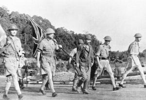 LieutenantGeneral Arthur Percival led by a Japanese officer walks under a flag of truce to negotiate the capitulation of Allied forces in Singapore on 15 February 1942