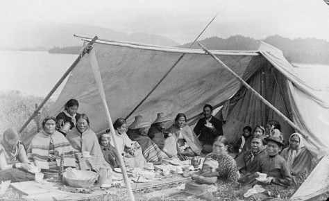 Members of the Tsimshian tribe hold a tea party near Fort Simpson, British Columbia, c. 1889 or 1890. The photograph was allegedly taken on the 1st of July.