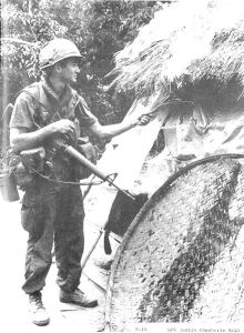 SP4 Dustin setting fire to dwelling (during the My Lai massacre)