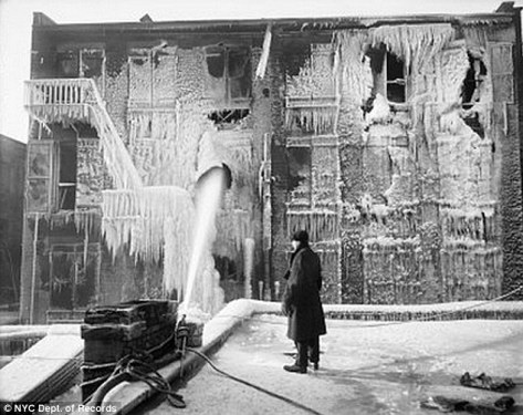 A man looks on at the mounds of frozen icicles following the FDNY extinguished a building fire in December 1917.