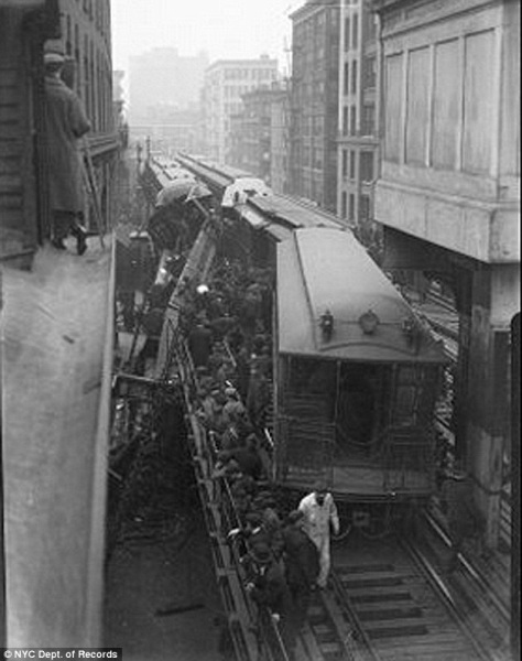 Vintage New York City. Fire fighters help evacuate riders after a collision on the elevated subway..