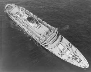 The SS Andrea Doria sinking after being struck by the SS Stockholm in 1956. Half of the ship's lifeboats are still onboard, a result of the severe list that developed after the ship was struck.Andrea_Doria_USCG_1