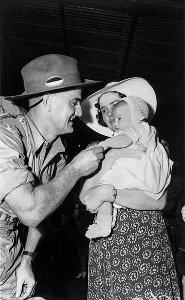 21 November 1941369px-StateLibQld_1_131771_Soldier_dad_greeting_his_wife_and_baby_on_arrival_home_on_leave_from_Darwin,_Brisbane,_November_1941