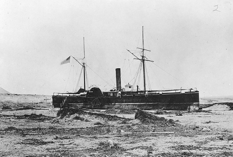 USS Wateree (1863) beached at Arica after she was deposited there by a tidal wave on 13 August 1868. Her iron hull was reasonably intact but salvage was not economical and she was sold where she lay.
