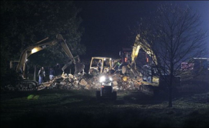 The Amish school in Nickel Mines, Pa., where a gunman shot 10 girls last week, killing five of them, is demolished by private contractors before dawn today.10122006