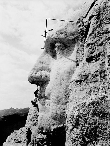 451px-Mount_Rushmore2Construction at Mount Rushmore of George Washington's likeness. circa 1932