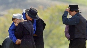A-community-drawn-together-in-mourningMembers of the Nickel Mines Amish community came together to share their sorrow the day after the shooting.