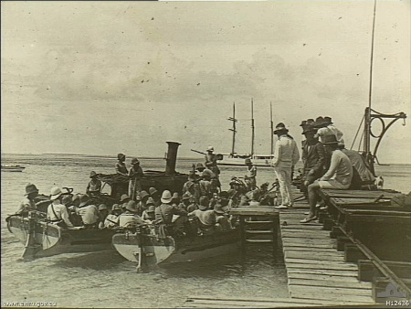 A landing party from the German Navy cruiser Emden leaving the jetty of Direction Island, Cocos (Keeling) Islands in the Indian Ocean jetty on 9 November 1914 during World War I.