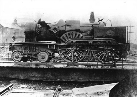 North British Railway locomotive 224, recovered from the water after the Tay Bridge disaster. Originally issued as a postcard captioned Old Tay Bridge Disaster, 1879 The Engine. 1880.