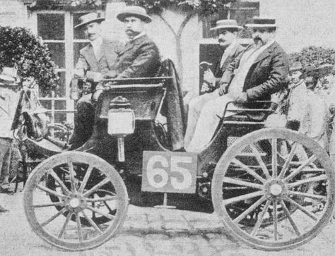 #65 Albert Lemaître in Peugeot 3hp at 1894 Paris-Rouen race (2nd place) but judged the official winner. Adolphe Clément is the front seat passenger.