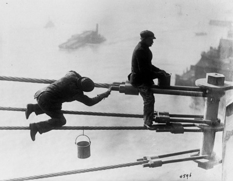 Brooklyn Bridge painters at work high above the city, on December 3, 1915.