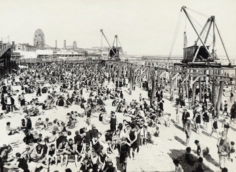 Coney Island looking east from Steeplechase Pier showing Sunday bathers, crowd on beach, on July 30, 1922.