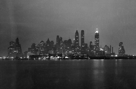 Lower Manhattan skyline at night, seen from either the Staten Island Ferry or Governor's Island, in February of 1938.