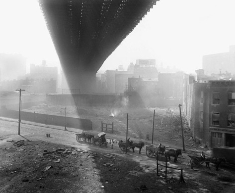 Shadows are cast beneath the Brooklyn Bridge, seen from a stable roof, on May 6, 1918.