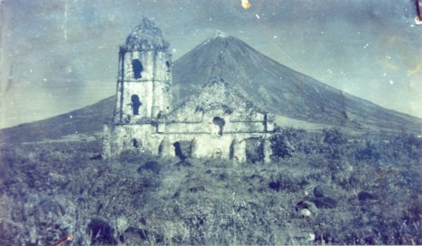 An old photograph of the Cagsawa ruins with the façade still standing. The church was largely destroyed during the 1814 eruption of Mayon.