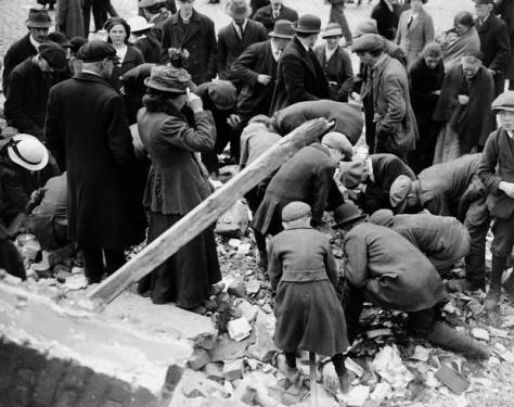 File photo dated 11-05-1916 of souvenir hunters of all ages scrabble amongst the rubble in the streets of Dublin in the aftermath of the 'Easter Rising'.