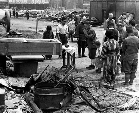 People conduct a funeral at a makeshift altar in central Tokyo on May 26, 1945, after a U.S. bombing.