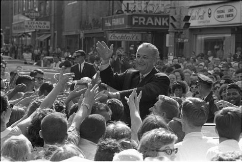 President Lyndon B. Johnson shakes hands with crowd members 30th June 1966