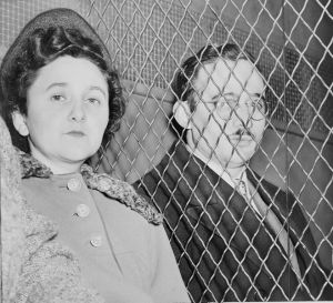Julius and Ethel Rosenberg, separated by heavy wire screen as they leave U.S. Court House after being found guilty by jury.