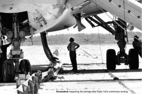 6.Inspecting the damaged aircraft after landing at Gimli - 23 July 1983.