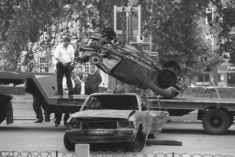 Cars removed from the scene of the Hyde Park car bomb in which four soldiers died in 1982