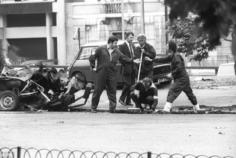 Police forensic officers working on the remains of the IRA car which housed the Hyde Park car bomb in which four soldiers died in 1982