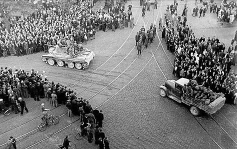 800px-Riga_1940_Soviet_ArmyA Soviet BT Tank with a truck and troops in the centre of Riga, 1940.