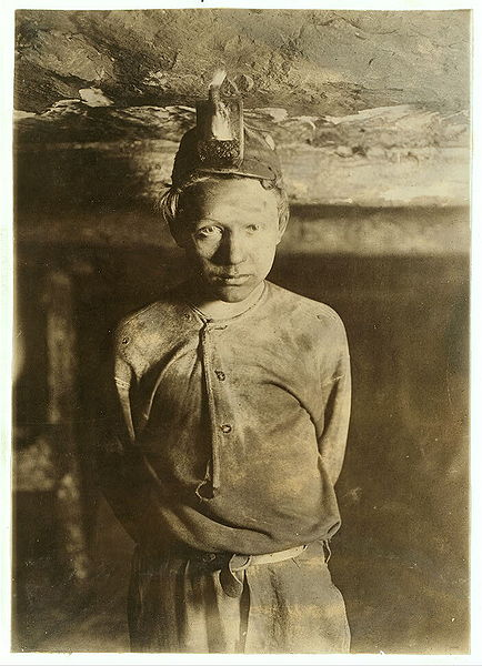 October 1908 434px-Trapper_BoyTrapper Boy, Turkey Knob Mine, Macdonald, W. Va. Boy had to stoop on account of low roof, photo taken more than a mile inside the mine. Witness E. N. Clopper. MacDonald, West Virginia.