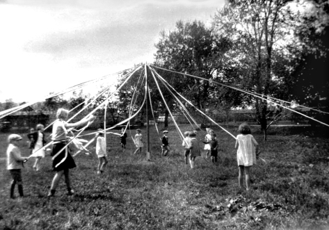 friends_and_family__maypole_dance-may-dance-celebrated-in-the-context-of-the-victoria-day-the-queens-day-children-dance-around-the-pole-on-which-the-ribbons-are-attached-24th-may-1934-quebec-can