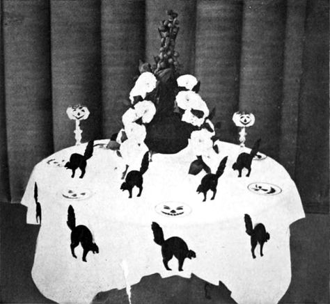 internal-illustration-from-the-book-of-halloween-depicting-a-black-cat-table-halloween-tables-august-1919