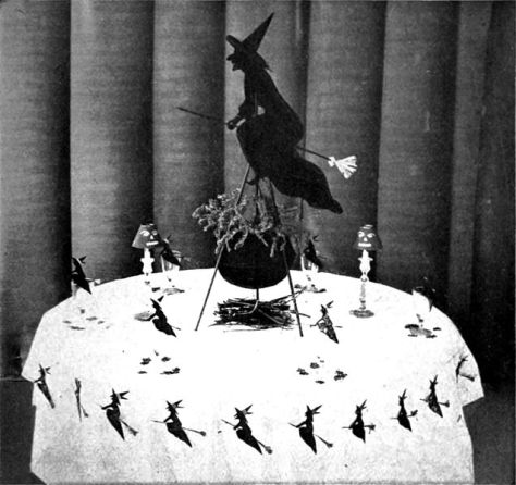 internal-illustration-from-the-book-of-halloween-depicting-a-witch-table-halloween-tables-august-1919