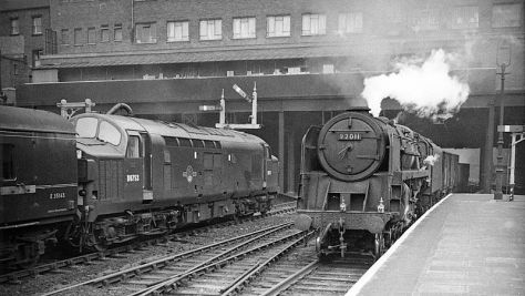 the-down-freight-and-up-express-at-nottingham-victoria-station-england-on-the-12th-of-october-1962