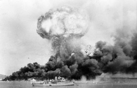 800px-Darwin_42The explosion of an oil storage tank and clouds of smoke from other oil tanks hit during the first Japanese air raid on Australia's mainland, at Darwin on 19 February 1942.
