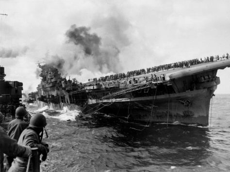 Attack_on_carrier_USS_Franklin_19_March_1945The USS Franklin, an American aircraft carrier, was struck by a Japanese dive bomber on the 19th of March, 1945.
